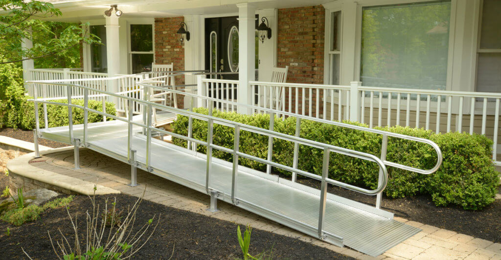 Wheelchair ramp outside front door of home