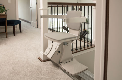 Empty Stairlift at top of steps